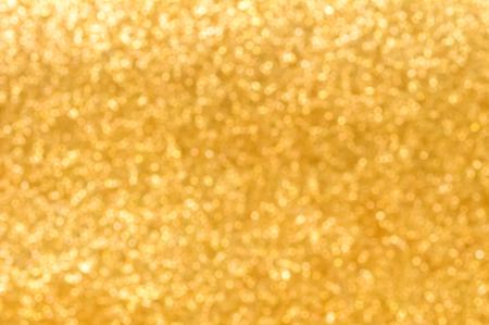 golden  gleam: Blur sparkle glittering gold abstract background Stock Photo