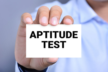 aptitude: APTITUDE TEST, message on the card shown by a man
