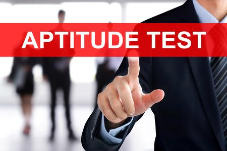 aptitude: Businessman hand touching APTITUDE TEST tab on virtual screen Stock Photo