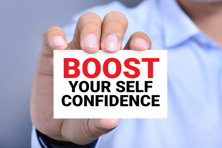 Self Confidence: BOOST YOUR SELF CONFIDENCE, message on the card shown by a man