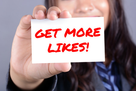 likes: Businesswoman showing card with GET MORE LIKES ! message