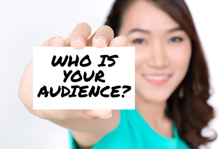 business strategy: WHO IS YOUR AUDIENCE ? message on the card shown by a woman