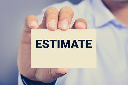 cost estimate: ESTIMATE word on the card shown by a man, vintage tone