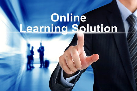 online service: Businessman hand touching Online Learning Solution sign on virtual screen Stock Photo