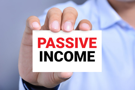 passive: PASSIVE INCOME, message on the card shown by a man