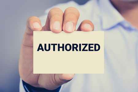 authorized: AUTHORIZED word on the card shown by a man, vintage tone