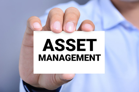 shown: ASSET MANAGEMENT word on the card shown by a man Stock Photo