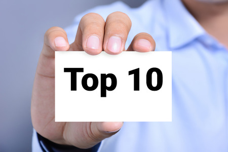 white achievement: Top 10 sign shown by a man
