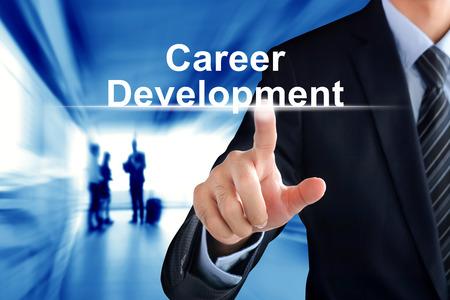 career development: Businessman hand touching Career Development sign on virtual screen Stock Photo