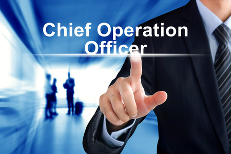 coo: Businessman hand touching Chief Operation Officer (or COO) sign on virtual screen