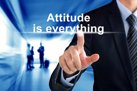 attitudes: Businessman hand touching Attitude is everything message on virtual screen