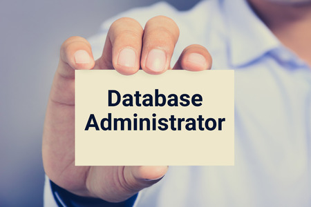 administrators: Database Administrator, words on the card shown by a man, vintage tone