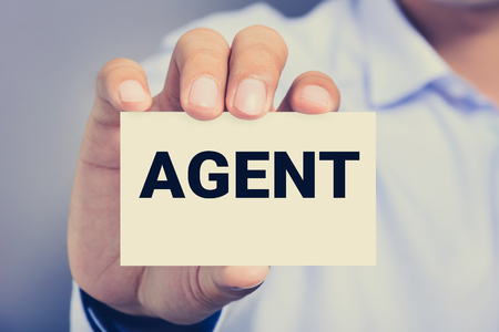 middleman: AGENT word on the card shown by a man, vintage tone Stock Photo