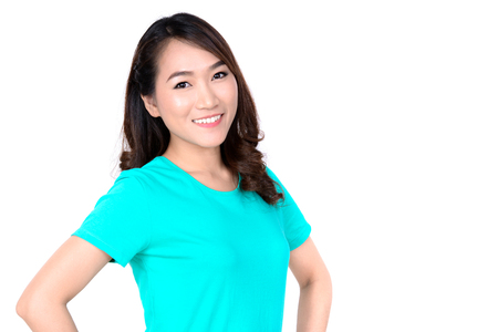 women smiling: Portrait of smiling young Asian woman in casual t-shirt isolated on white background Stock Photo