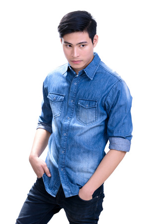 young male: Portrait of handsome young Asian man in blue jean shirt - on white background