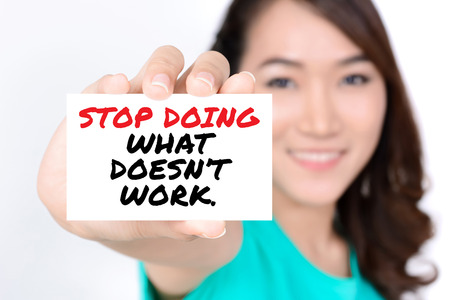 card stop: STOP DOING WHAT DOESNT WORK, message on the card shown by a woman
