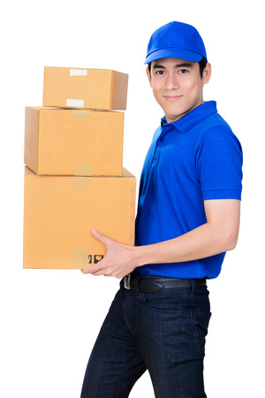 deliveryman: Smiling friendly delivery man carrying parcel boxes on white background Stock Photo