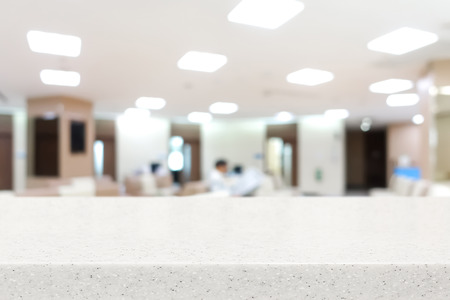 Stone countertop on blur hospital lobby background  - can be used for display or montage your products