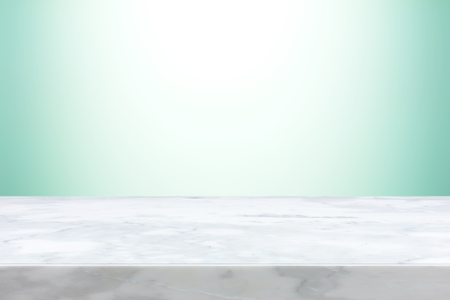 Marble stone table top on light blue gradient abstract background  - can be used for display or montage your products
