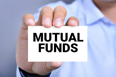 mutual funds: MUTUAL FUNDS, message on the card shown by a man Stock Photo