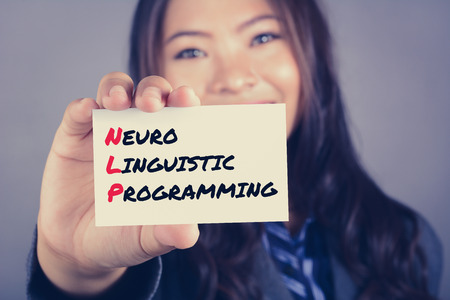 neuro: Neuro Linguistic Programming (or NLP) message on the card shown by a woman, vintage tone Stock Photo