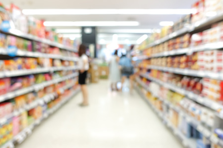 aisle: Blur image of aisle in supermarket with customers - for background