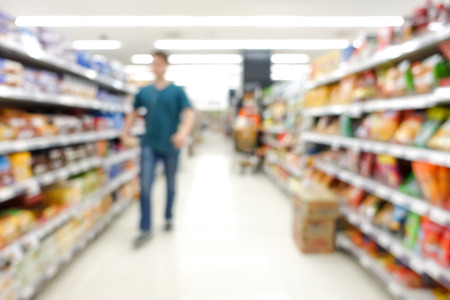 aisle: Blur image of aisle in supermarket with customer - for background
