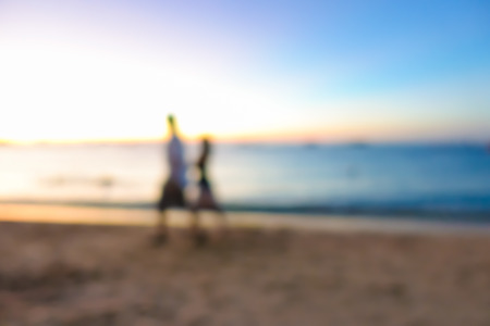 couple nature: Blur image of couple walking at the beach in twilight, can be used for background