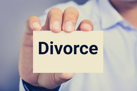 shown: Divorce word on the card shown by a man Stock Photo