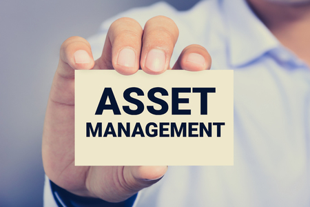 allocation: ASSET MANAGEMENT word on the card shown by a man Stock Photo