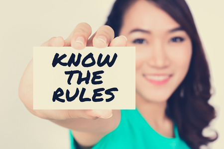 guidance: KNOW THE RULES, message on the card shown by a woman, vintage tone Stock Photo