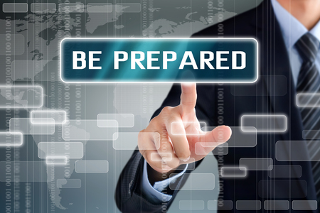Businessman hand touching BE PREPARED sign on virtual screen