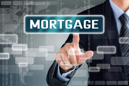 pledge: Businessman hand touching MORTGAGE sign on virtual screen