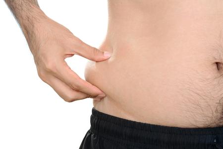 fitness hombres: vientre hombre con exceso de grasa Foto de archivo