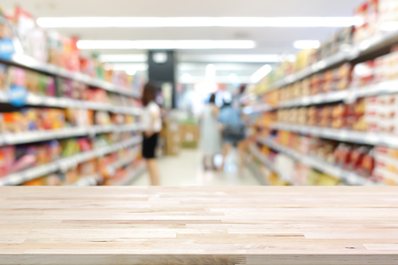 hypermarket: Wood table top on blur supermarket background - can be used for display or montage your products