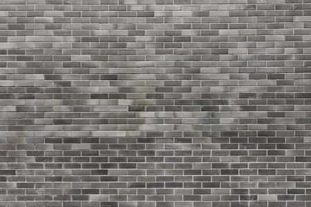 Grijze bakstenen muur textuur voor de achtergrond Stockfoto