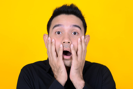 A man expressing shocked and scared face, feeling and emotion concept Stock Photo