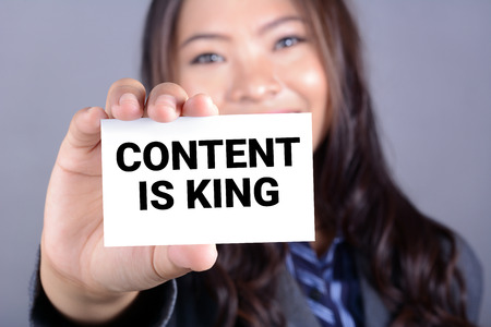 news values: CONTENT IS KING, message on the card shown by a woman