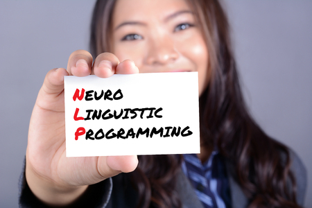 linguistic: Neuro Linguistic Programming (or NLP) message on the card shown by a woman