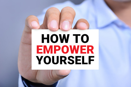empower: HOW TO EMPOWER YOURSELF message on the card shown by a man