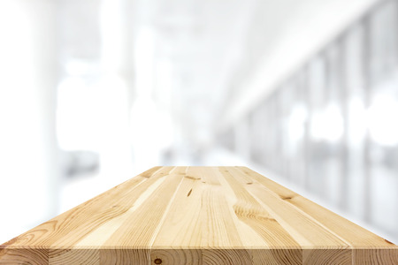 Natural pattern wood table top on white blur background - can be used for display or montage your products