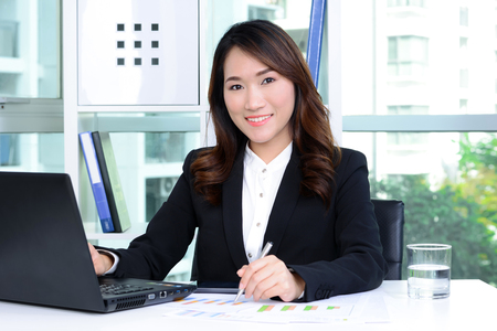 asian businesswoman: Smiling Asian businesswoman working in the office Stock Photo