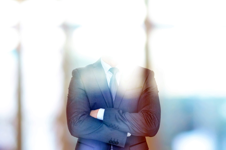 success man: Anonymous businessman crossing his arms Stock Photo