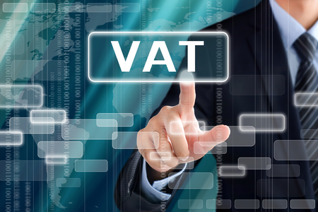 Businessman hand touching VAT (or Value Added Tax) sign on virtual screen