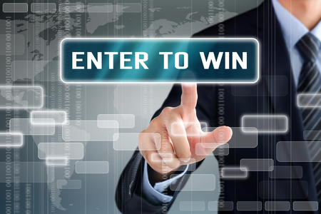 Businessman hand touching ENTER TO WIN message on virtual screen