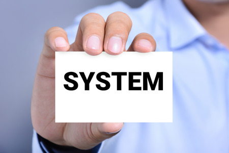 systematic: SYSTEM word on the card shown by a man