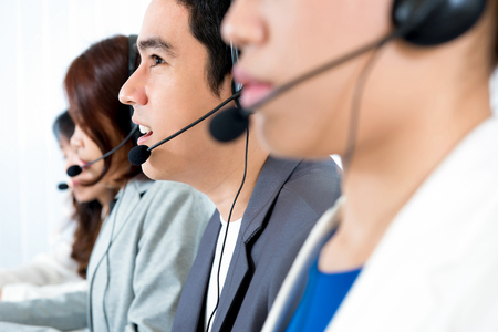 telemarketer: Call center (or telemarketer) team - customer service operator concept