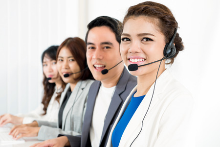 telemarketer: Smiling call center (or telemarketer) team - customer service operator concept Stock Photo
