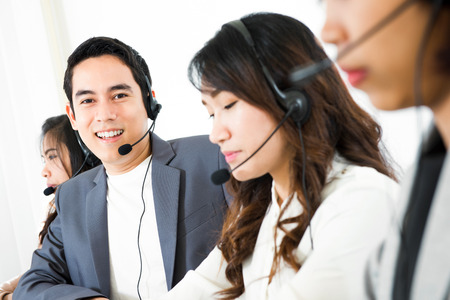 telemarketer: Call center ( telemarketer or operator) team - customer service and telemarketing concepts Stock Photo