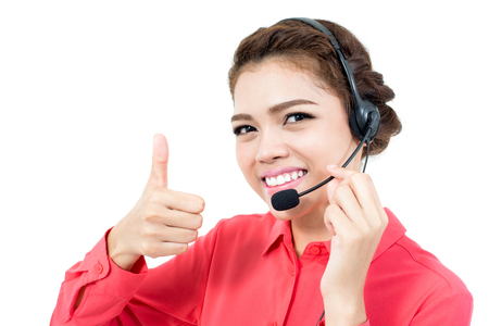 microphone headset: Young businesswoman  wearing microphone headset as an operator giving thumbs up